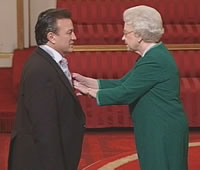 Glen Murphy getting MBE from the Queen